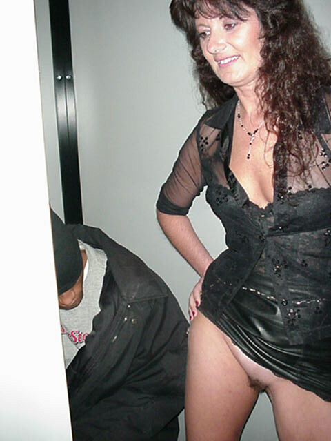 Wife at adult bookstore gloryhole
